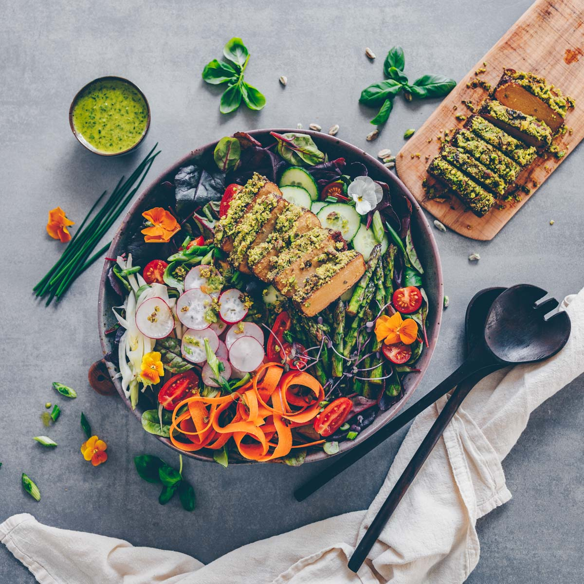 Spring salad and tofu with pistachio crust